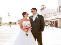 New Jersey wedding couple posing on boardwalk in sunglasses
