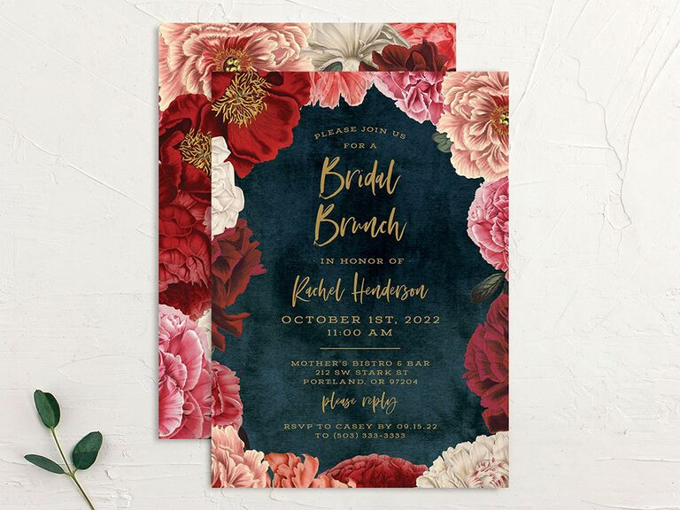 Pink and red flowers surrounding event details in gold type on velvet blue background
