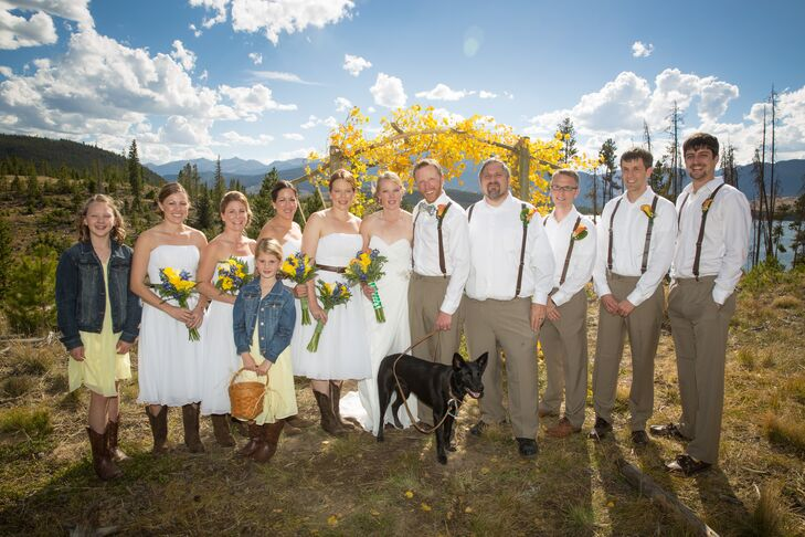 The bridesmaids wore casual strapless white dresses with brown belts and cowboy boots while the groomsmen wore khaki pants, white shirts and suspenders.