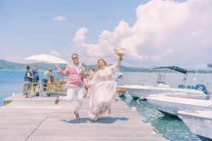 Couple Jumping for Joy After Ceremony at Ekies All Senses Resort in Greece