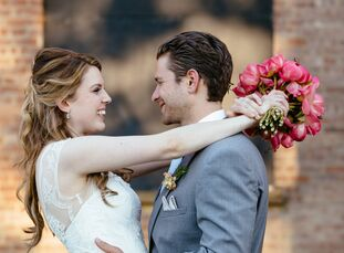 Kate Thomas (27 and a writer) and Jordan Friedson's (27 and a personal trainer) spring wedding was a fusion of industrial and timeless styles with a p