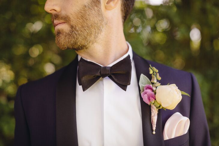 Brandon wore a custom dark blue tuxedo by Tiger of Sweden with black lapels and a black bow tie. His boutonniere was made up of an ivory peony and a pink orchid.