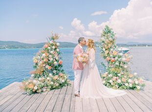 Madalina and Andrei exchanged vows at Ekies ALl Senses Resort after falling in love with Greece's Halkidiki peninsula. To complement their waterfront