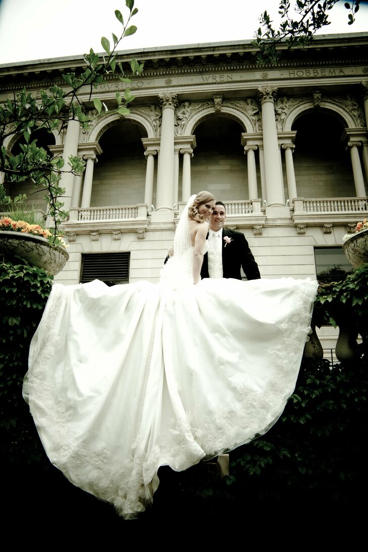 The bride designed her own wedding gown, made of silk organza and detailed with French Alencon lace, hand-cut silk fabric petals, Swarovski crystals and pearl spray. The gown's crowning glory was its nine-foot train.