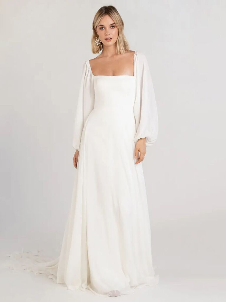 jenny yoo white a line wedding dress with square neckline long puffy sleeves and flowy skirt