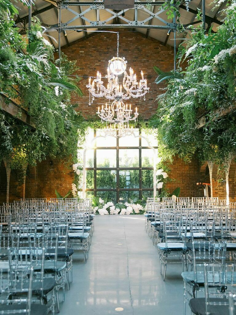 Loft venue with acrylic chairs and acrylic chandeliers