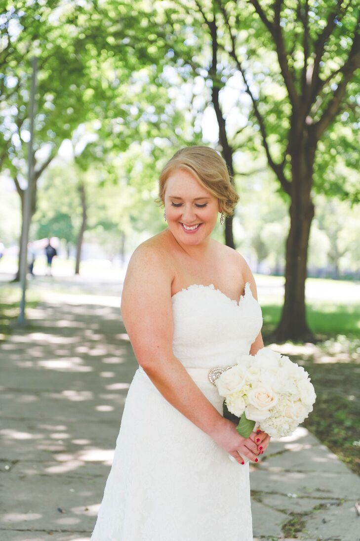 The bride opted for a sideswept updo and elegant drop earrings to go with her white lace Eugenia Couture wedding dress.
