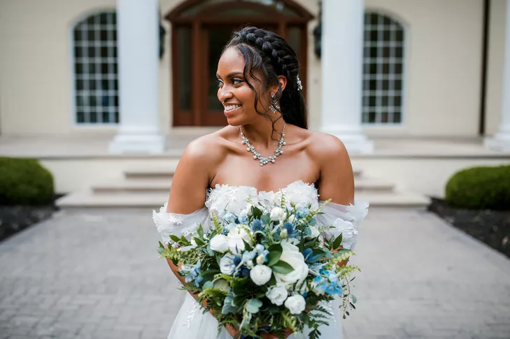 Bride in off-the-shoulder dress holding bouquet
