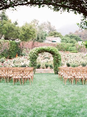 Wedding Arch Covered in Greenery