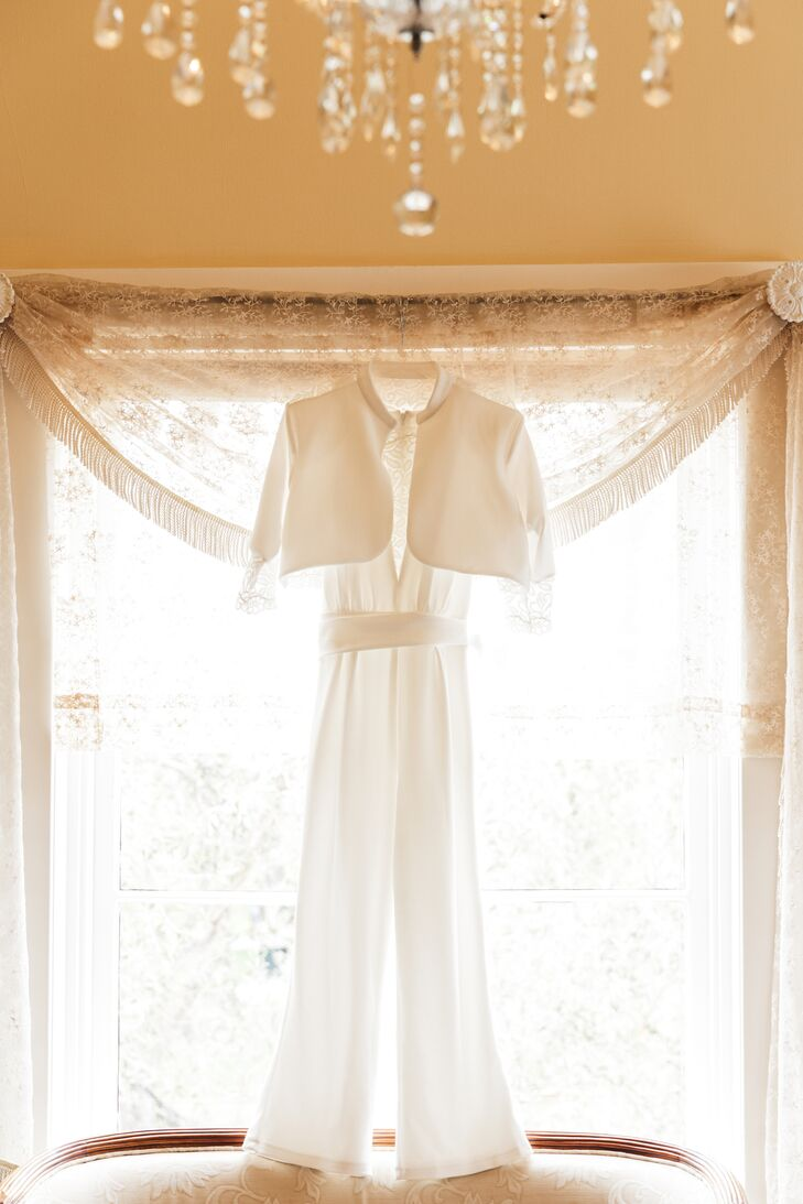 Mariko wore a chic, sleeveless woman's suit by Alumni Design in eggshell white with a plunging neckline covered with lace. She topped it off with a lace bolero to make it more formal.