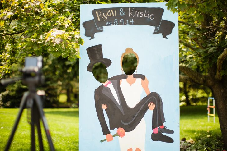 As soon as dinner ended, guests were welcome to explore the grounds. One of the first things they saw was a DIY photo booth that Ryan and his father made; everyone was able to plop their heads into the two spots and pretend they were Kristie carrying Ryan. Now that's personalized!