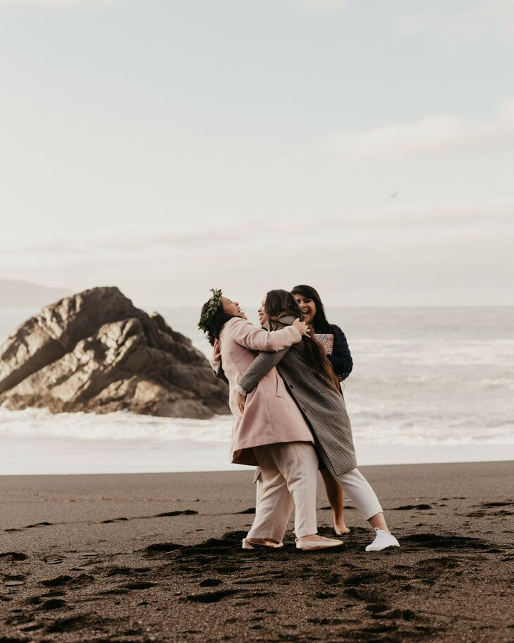 Couple Hugging During Sunrise Elopement on the Beach in San Francisco, California