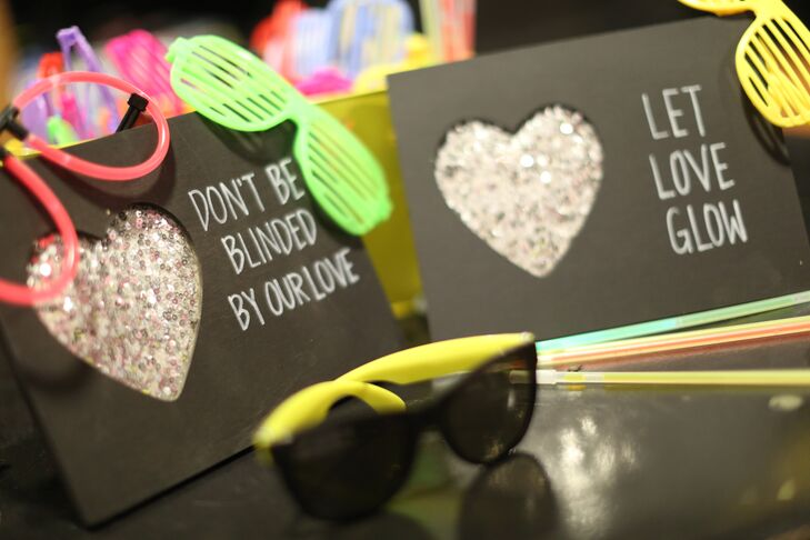 """""""Something about wearing sunglasses inside makes people dance like no one is watching,"""" Mallory says. To get people on the dance floor, the newlyweds gave their guests sunglasses, shutter shades, glow sticks and flip-flops as dance party props."""