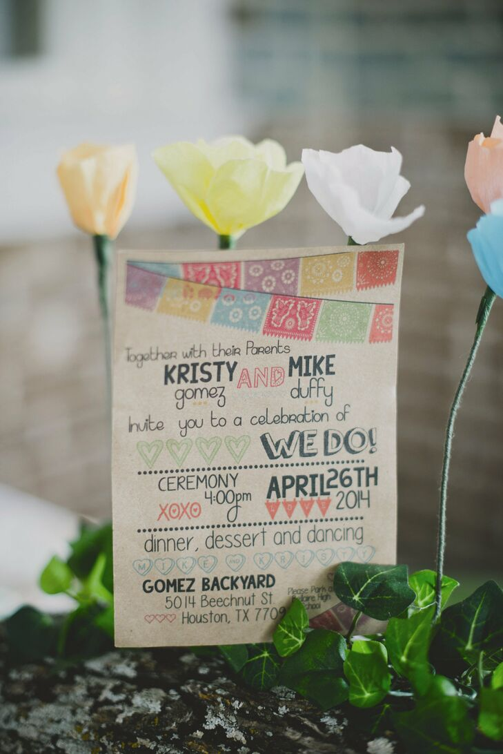 Kristin handmade the invitations from kraft paper. Pops of color in within the text added a whimsical touch to the invitations.