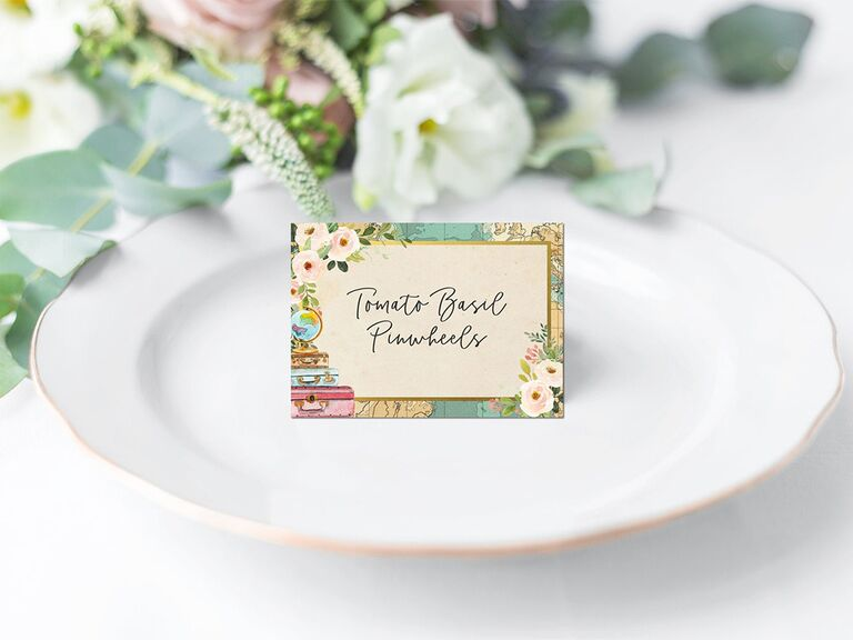 Card with map border and white florals and luggage icons