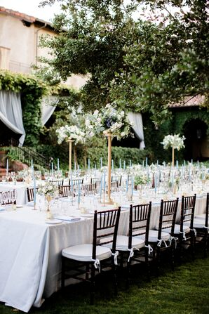 Formal Outdoor Reception with Tall Gold Centerpieces and Blue Taper Candles