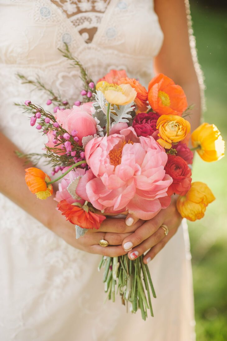 The bride wanted her flowers to be happy, joyous and free, and mixed peonies, poppies, ranunculus, dahlias and dusty miller to create her vibrant bouquet.