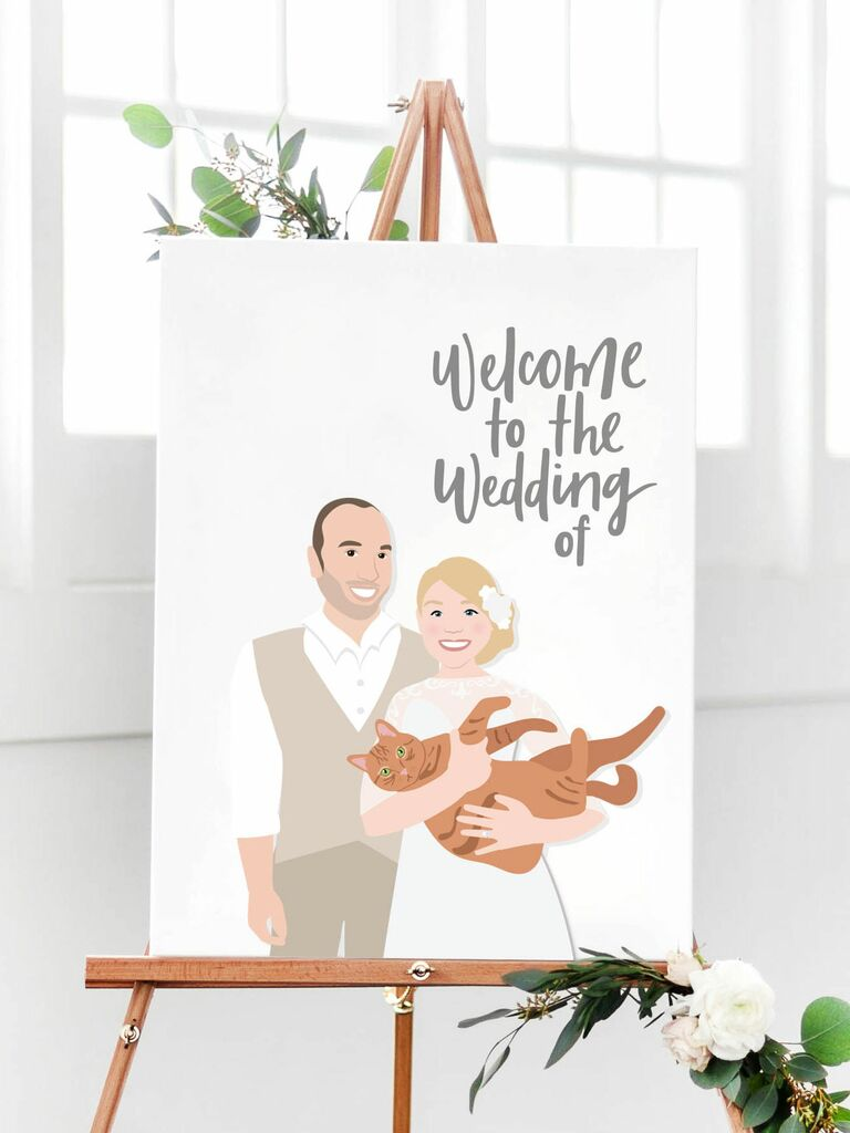 Couple portrait with cat wedding welcome sign