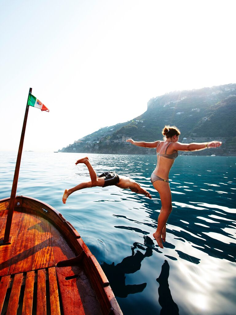Couple leaping off rental boat into Tyrrhenian Sea