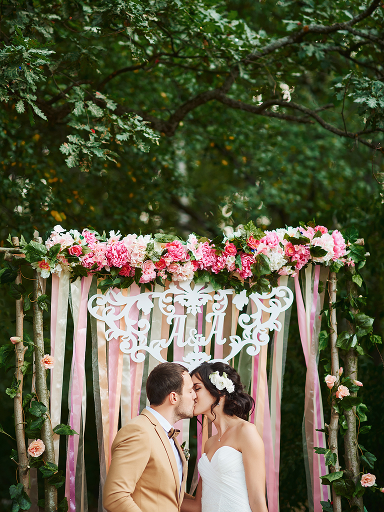 bride and groom in front of DIY photo booth