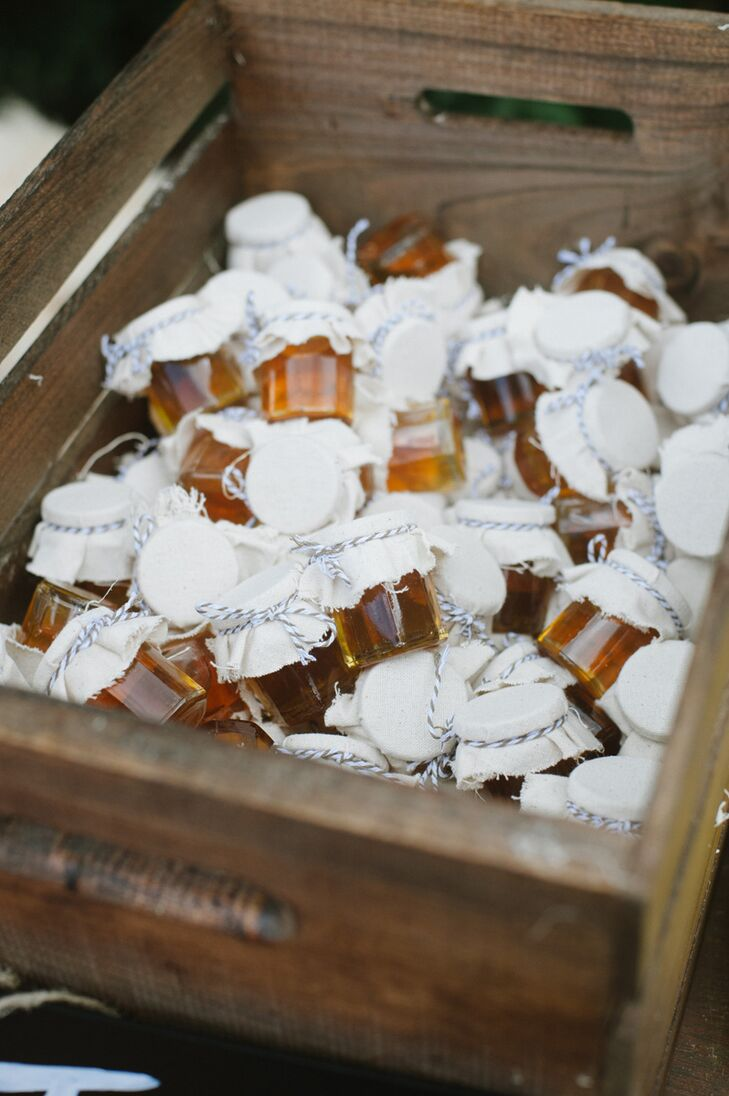 The couple crafted a wooden crate to house honey jars as favors for their guests.