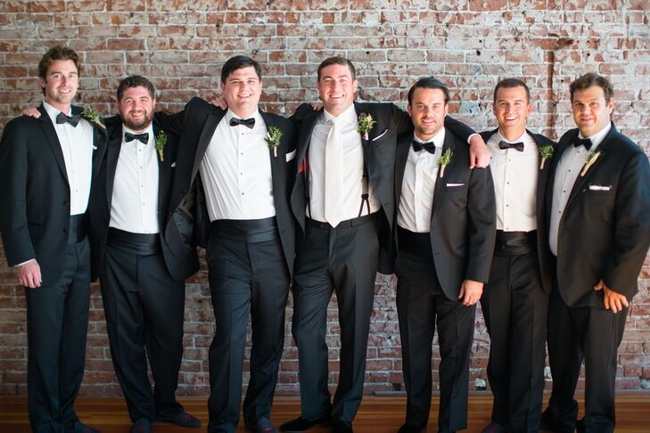 """""""Our venue was romantic and my husband wanted to look the part, so he wore a modern black tuxedo and tuxedo slippers,"""" Alexandra says. """"I've never seen him so dressed up."""""""