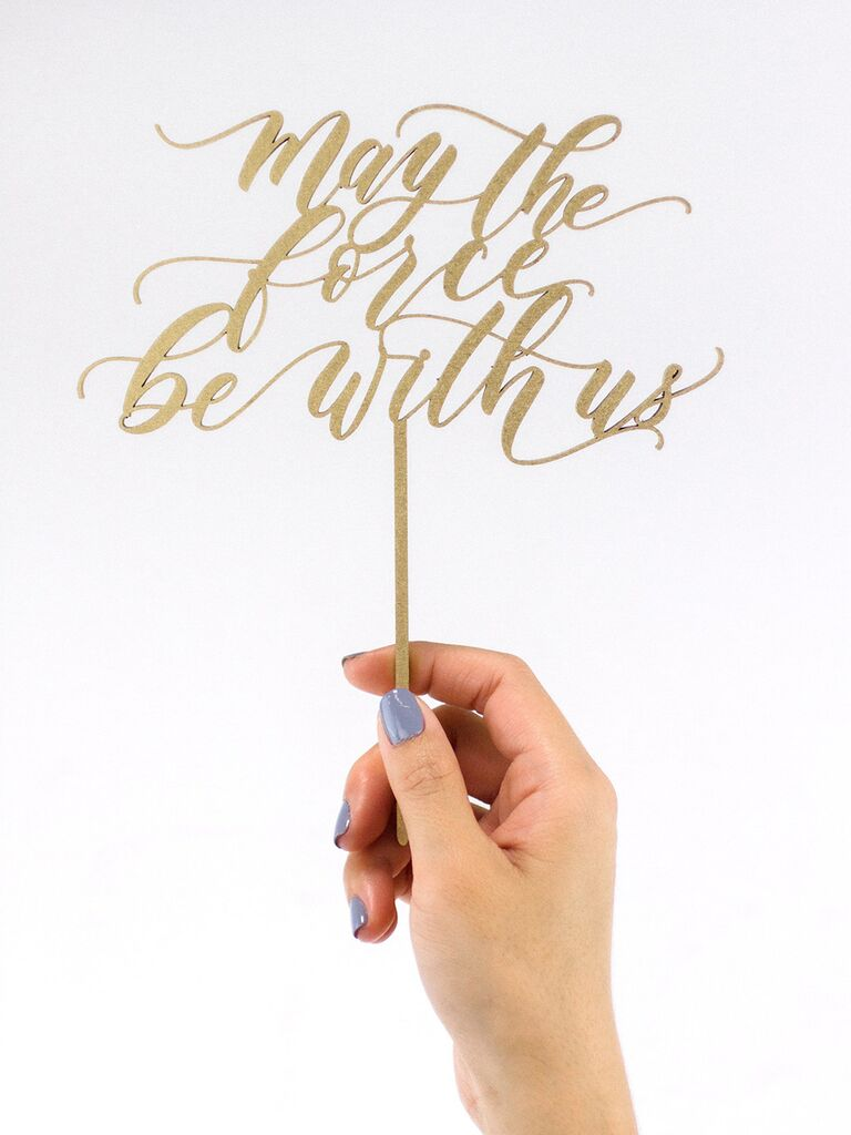 'may the force be with us' in loopy gold script