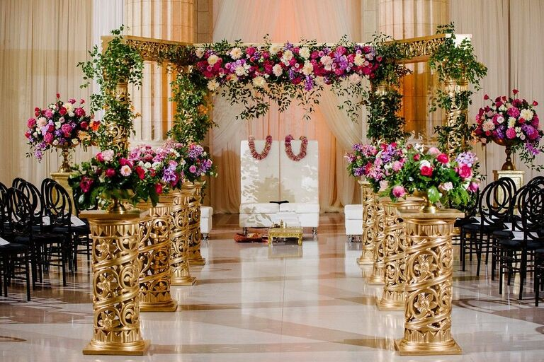 Gold-and-purple mandap in ballroom