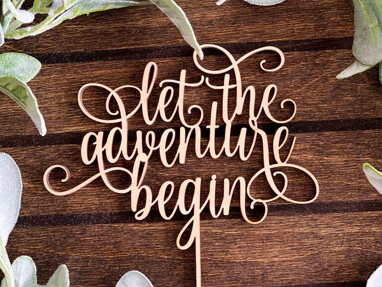 Wooden 'let the adventure begin' in elegant loopy script