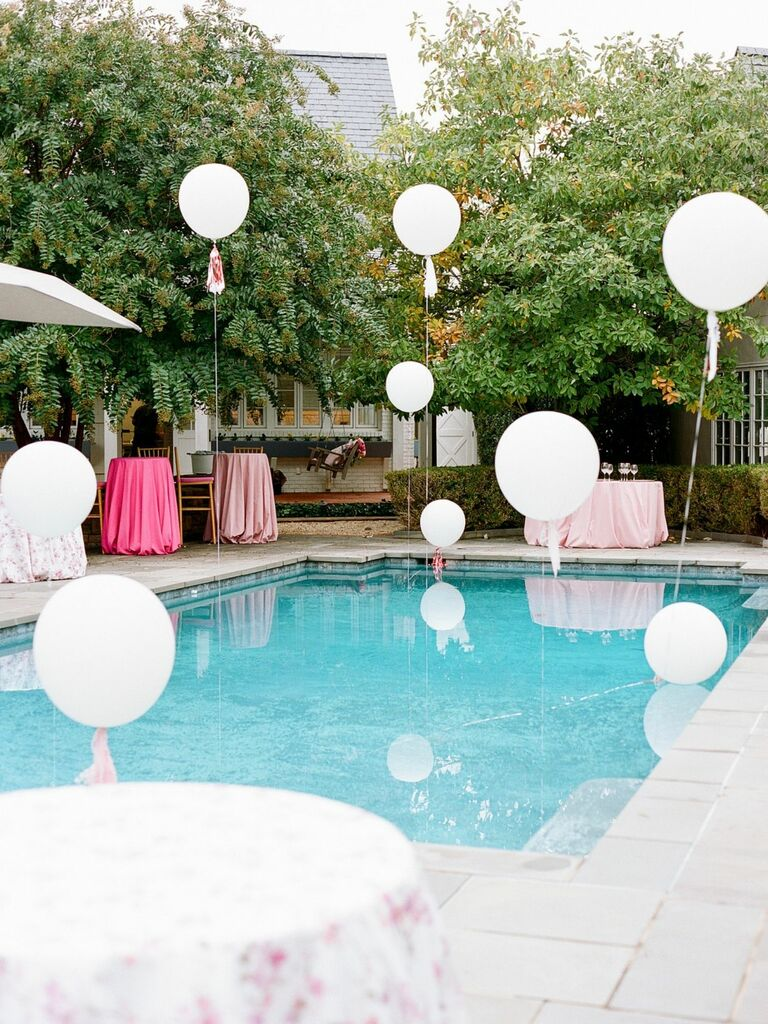 balloons floating above pool