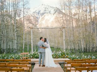 """Avid skiers and mountain bikers Julie Denison and Chase Marston hosted their """"I dos"""" atop Golden Ledge Mountain in Telluride, Colorado. """"We wanted to"""