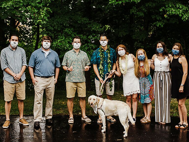 Bride and groom with wedding party wearing matching wedding masks