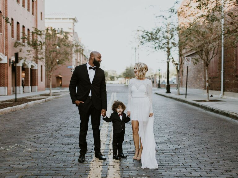 Couple holding hands with child
