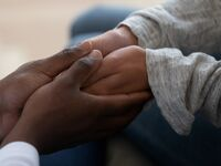 Black couple holding hands.