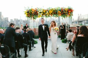 Modern Rooftop Recessional with Colorful Flowers, Clear Chuppah and Skyline Views