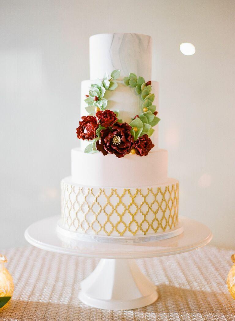 Preppy four-tier wedding cake with wreath decoration