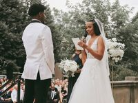 Couple exchanging vows during wedding ceremony.