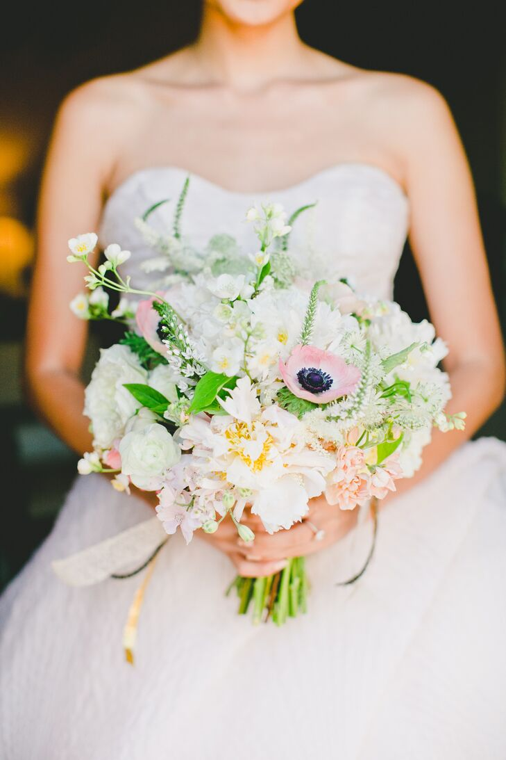"""Patricia let florist Michelle Jacob take full control of all of the florals, requesting only that the flowers complement the venue and that anemones be included in the centerpieces and bouquets. However, the drought in California made finding anemones a difficult task. """"Somehow my florist managed to find a vendor who was getting them imported,"""" says Patricia. """"A week before our wedding we were told the anemones were destroyed at customs. I was devastated, since they're my favorite flower, but two days before the wedding my wonderful florist was able to source the flowers! Anemones were limited, but we were able to incorporate them into all the bouquets, boutonnieres and a few centerpieces."""""""