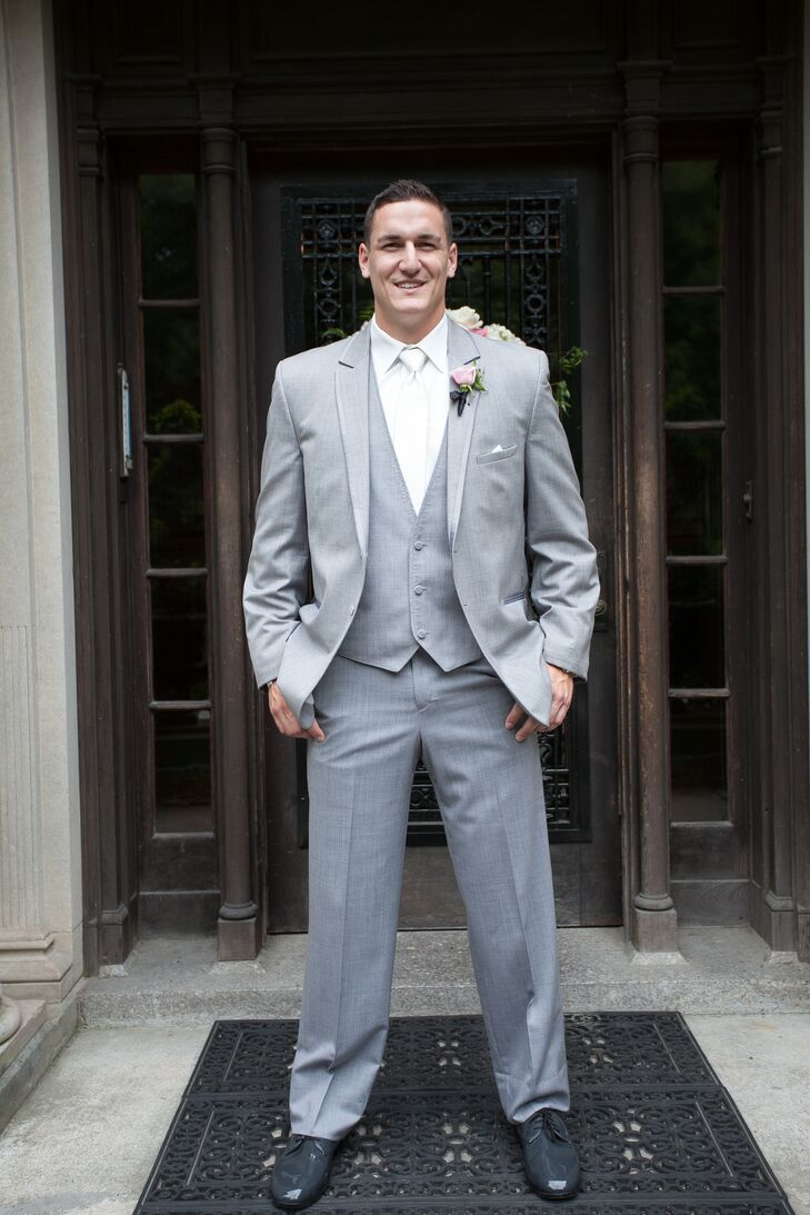 """PJ and his groomsmen wore gray suits and rose boutonnieres. """"It kept with the romantic feel, but was also summer friendly!"""" says the bride."""