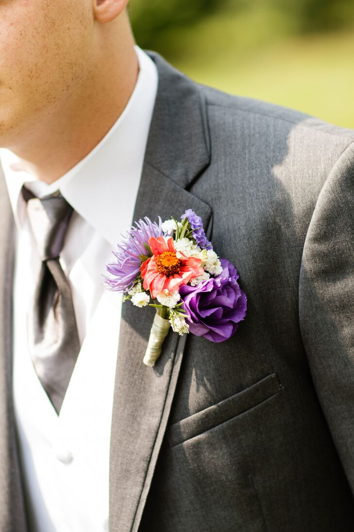 Ryan's boutonniere perfectly matched Kristie's lush bouquet with a bright arrangement. Its green wrap gathered a purple rose, purple delphiniums, white wildflowers, purple dianthus and a coral daisy to represent their wedding colors.