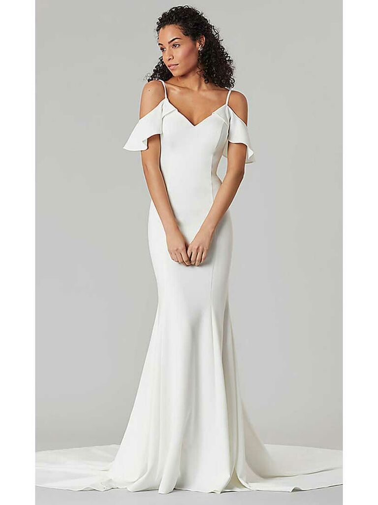 Simple fit-and-flare wedding dress with cold shoulders