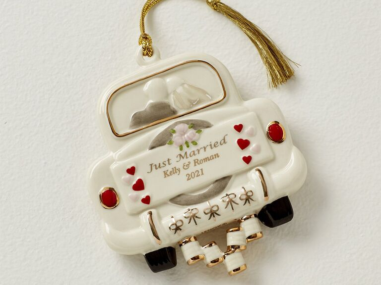 Vintage white car ornament with red heart details and 'Just married' in gold type