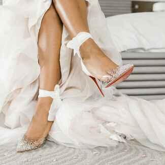 Bride wearing sparkly wedding heels with fabric ties