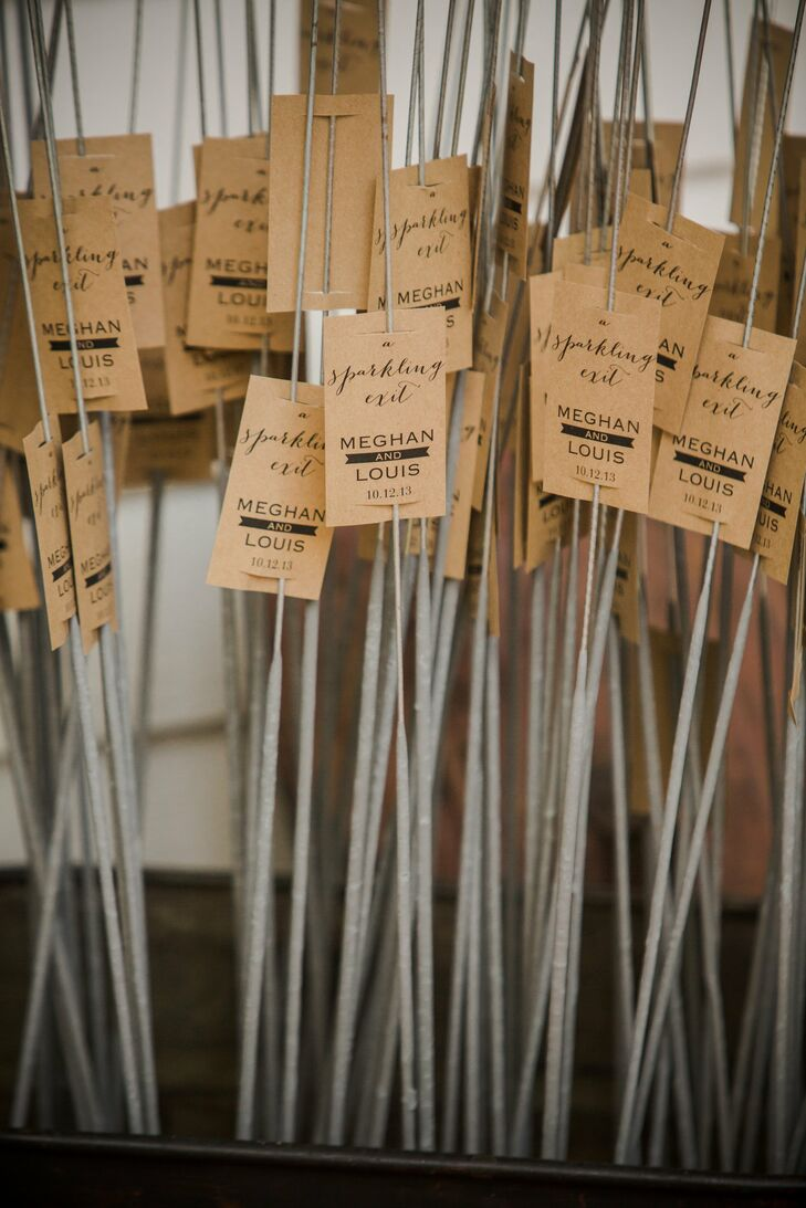 Kraft paper tags, that matched the rest of the wedding stationery, decorated the sparklers that were used for the couple's final getaway.