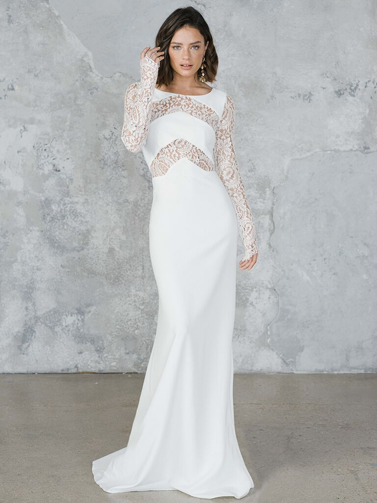 Long sleeve fitted dress with lace cutouts.