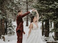 Couple dancing in the snow during mountain elopement