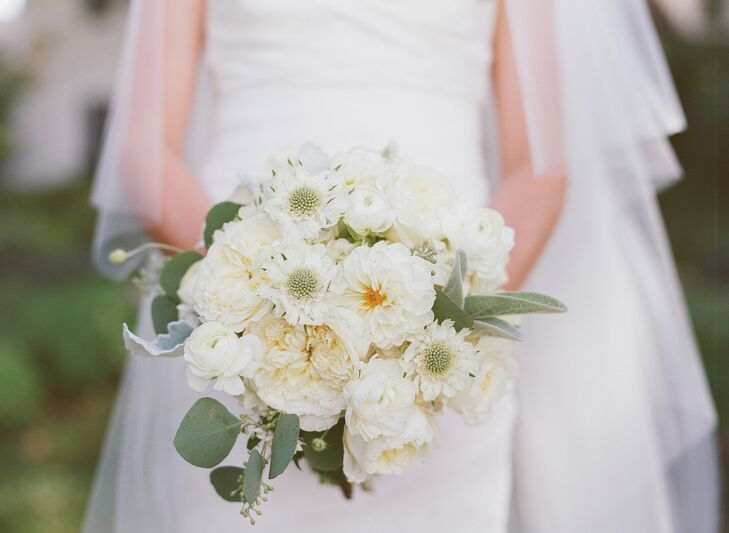 """""""My bouquet and all the flowers at the reception were very natural—all whites, creams and lots of mint greenery,"""" says Casey. """"I really wanted peonies, but since they weren't in season, we used a variety of similar flowers instead."""""""