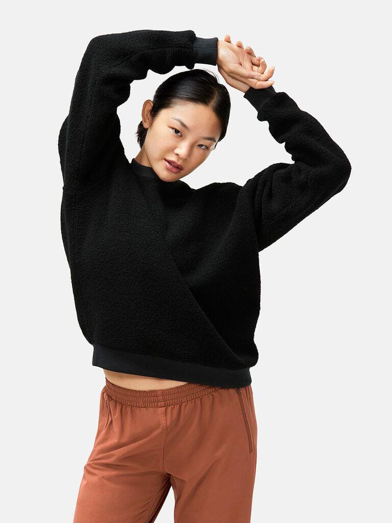 Model wearing fleece wool sweatshirt seventh anniversary present