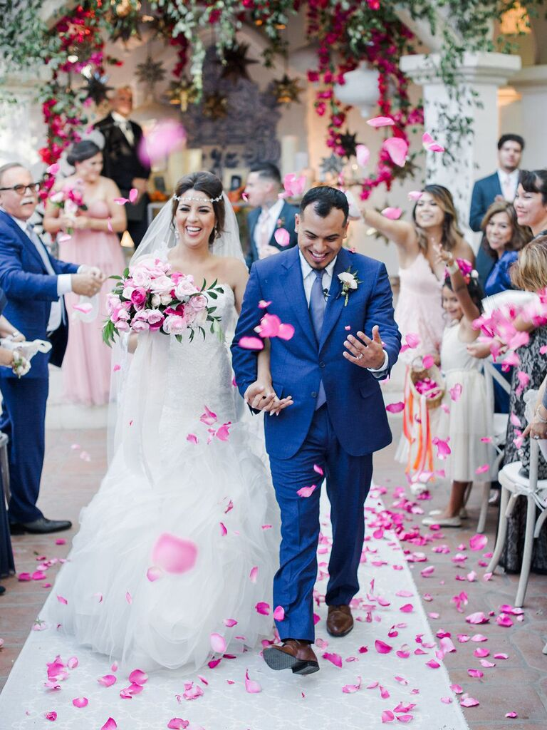 Rose petal wedding exit toss