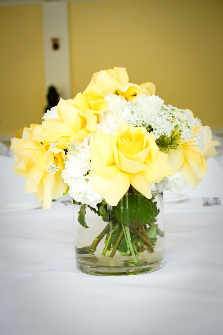 The reception took place inside the Lindley-Scott House, where guests were seated at dining tables with white tablecloths decorated with flower centerpieces. This particular arrangement had a mix of yellow roses, white hydrangeas and Queen Anne's lace.